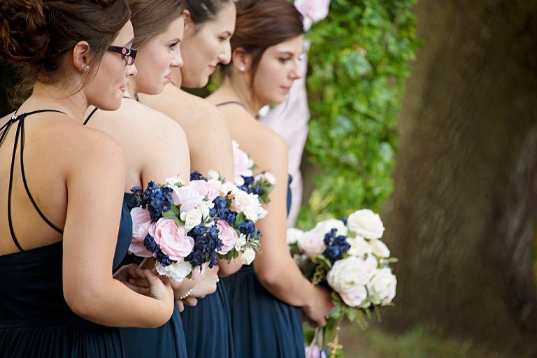 Pink and navy silk flowers for backyard wedding